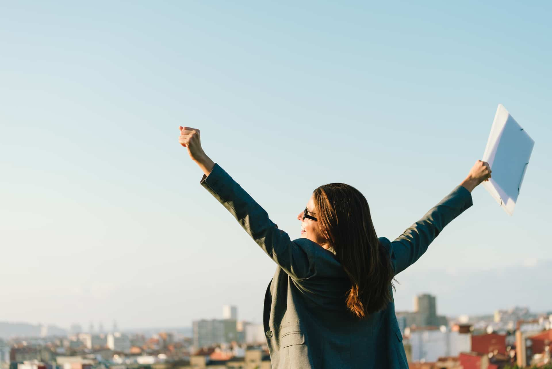 Female accountant feeling free on a rooftop